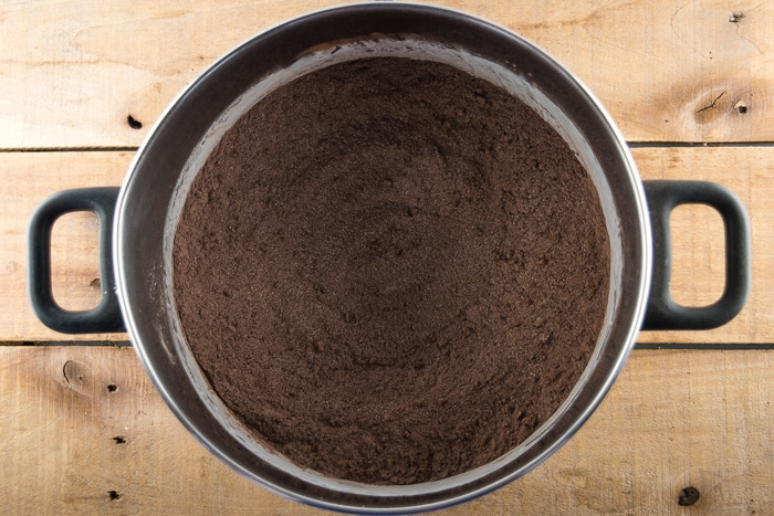 Cocoa And Sugar Mix For Making Chocolate Pudding In A Large Pot.