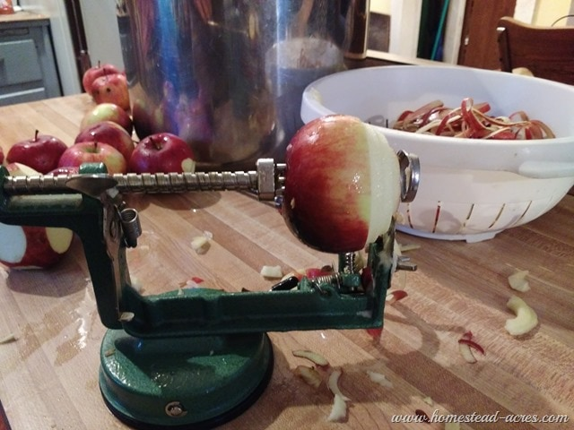 Peeling apples with a crank peeler