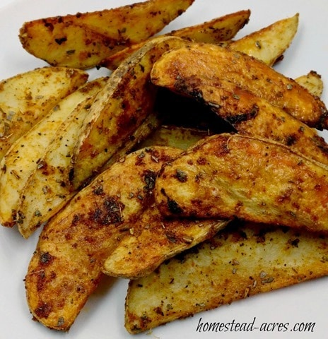 These oven baked potato wedges are amazing!!   www.homestead-acres.com
