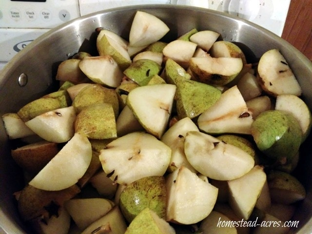 Cut up pears for making pear butter | www.homestead-acres.com