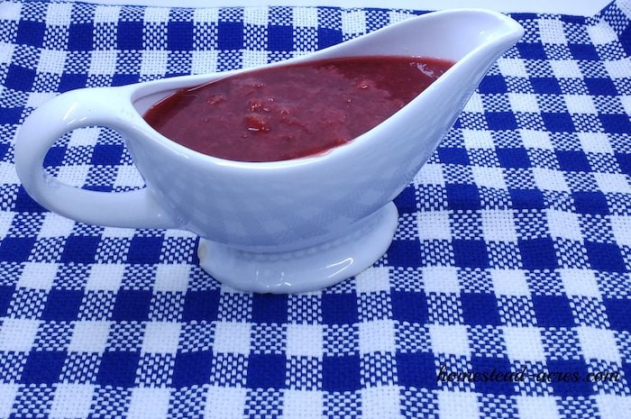 Fresh strawberry syrup in a serving dish.