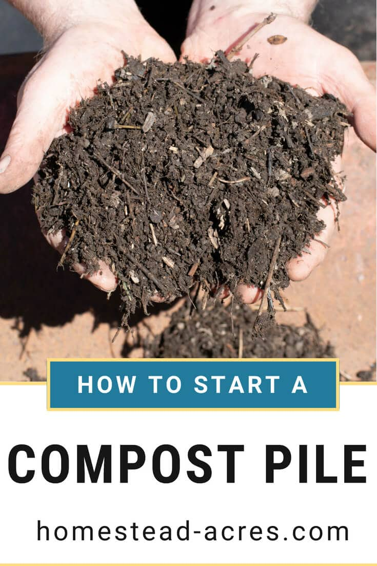 How To Start A Compost Pile text overlaid on a photo of finished compost being held in a mans hands over a wheelbarrow.