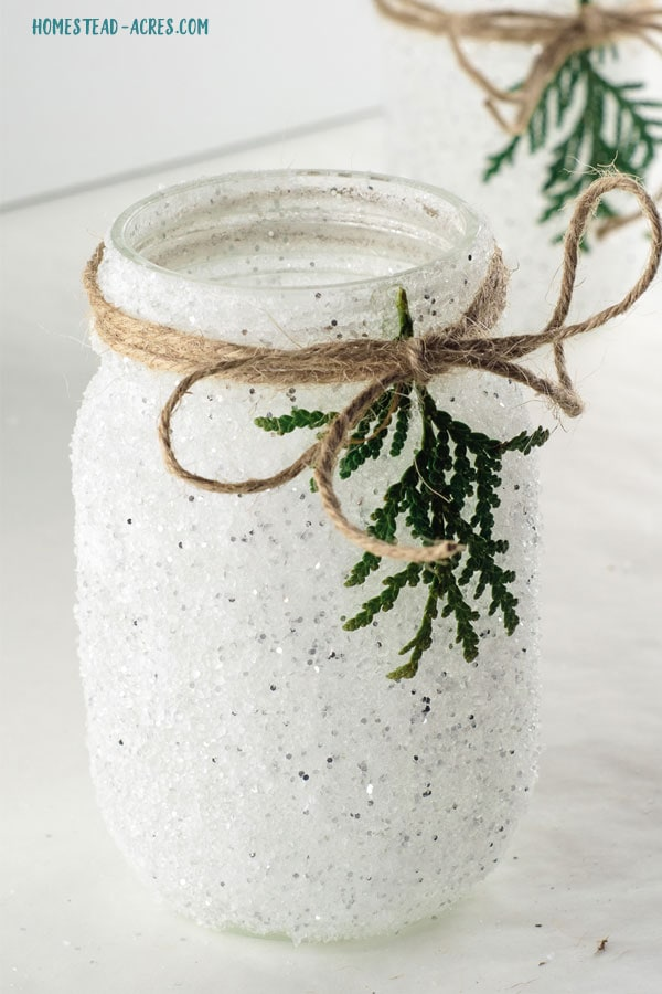 Close up of the completed snowy mason jar candle holder.