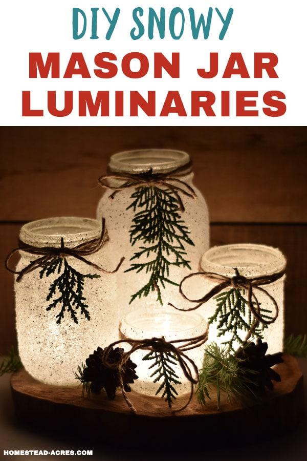 Set of 4 mason jar candle holders on a wooden slice with overlaid text DIY Snowy Mason Jar Luminaries.