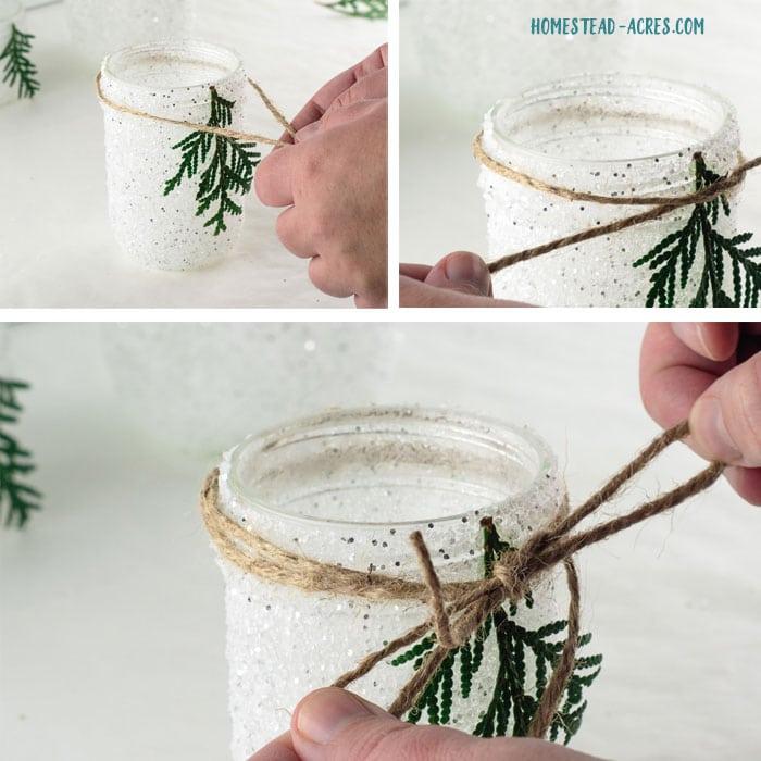 Tying a twine bow around the jar.