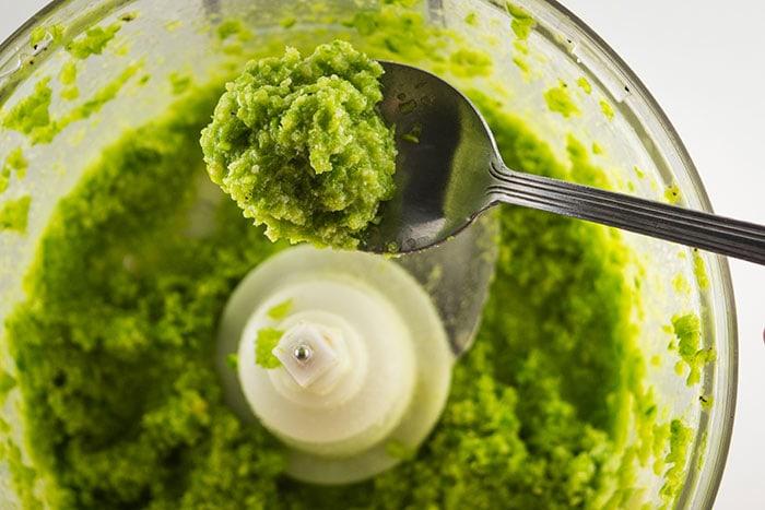 Spooning up some fresh garlic scape pesto.
