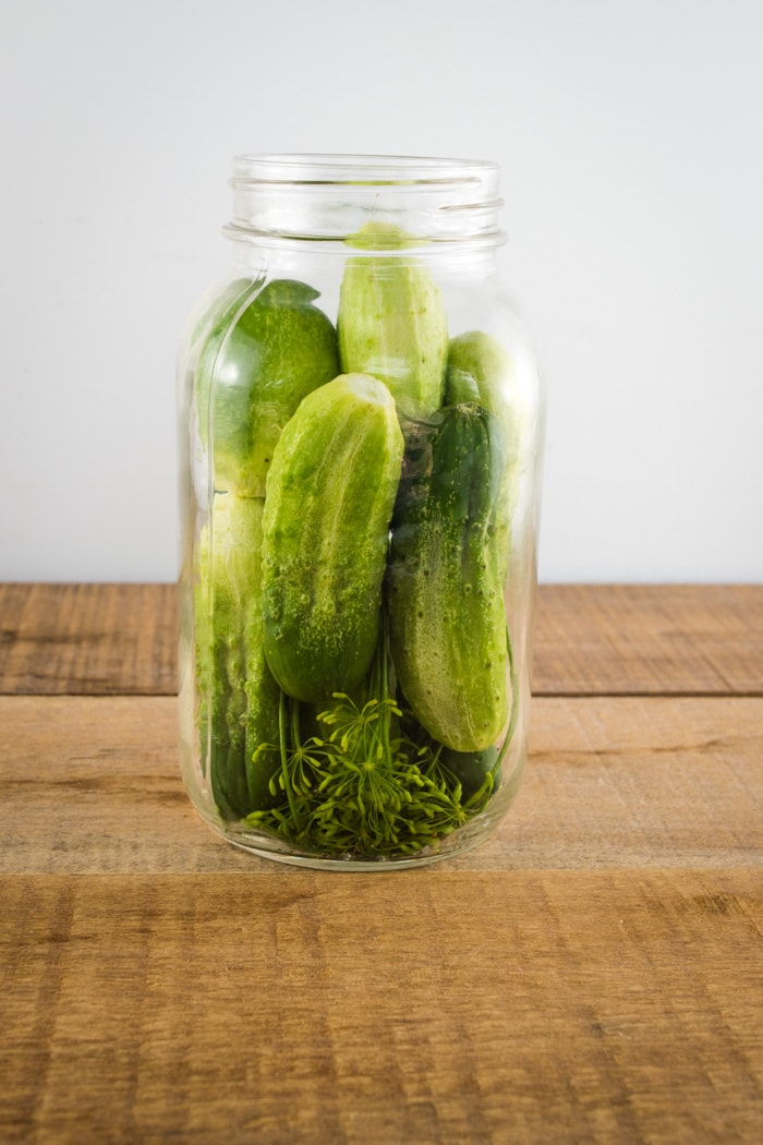 Packing cucumbers into jars.