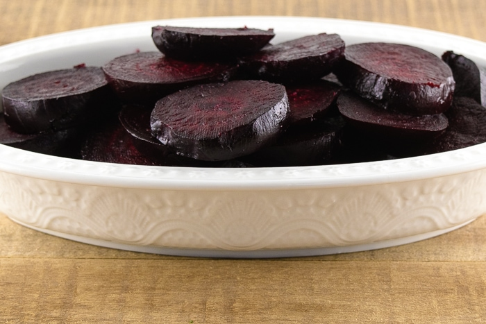 White serving tray filled with sweet roasted beets.
