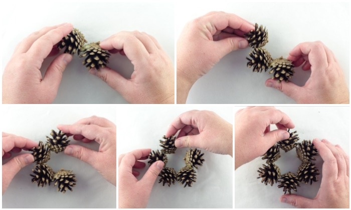 Gluing pinecones together to make a small wreath shape.