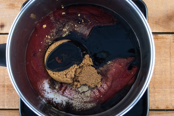Molasses and brown sugar mixture in a pot to cook to make the sauce.
