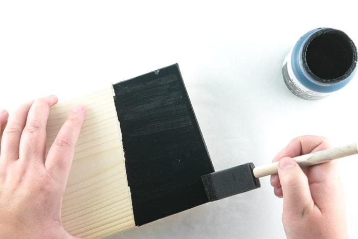Paint the hat with black chalk paint.