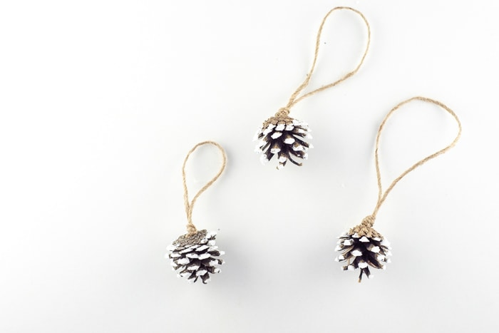 3 snowy pinecone ornaments finished and ready to hang up.