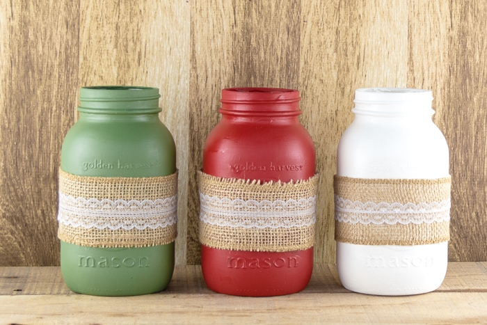 Set of 3 Christmas Mason Jars Green, Red, And White With Burlap Ribbon.