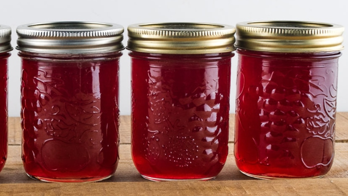 Jars of homemade jelly that have set firm.