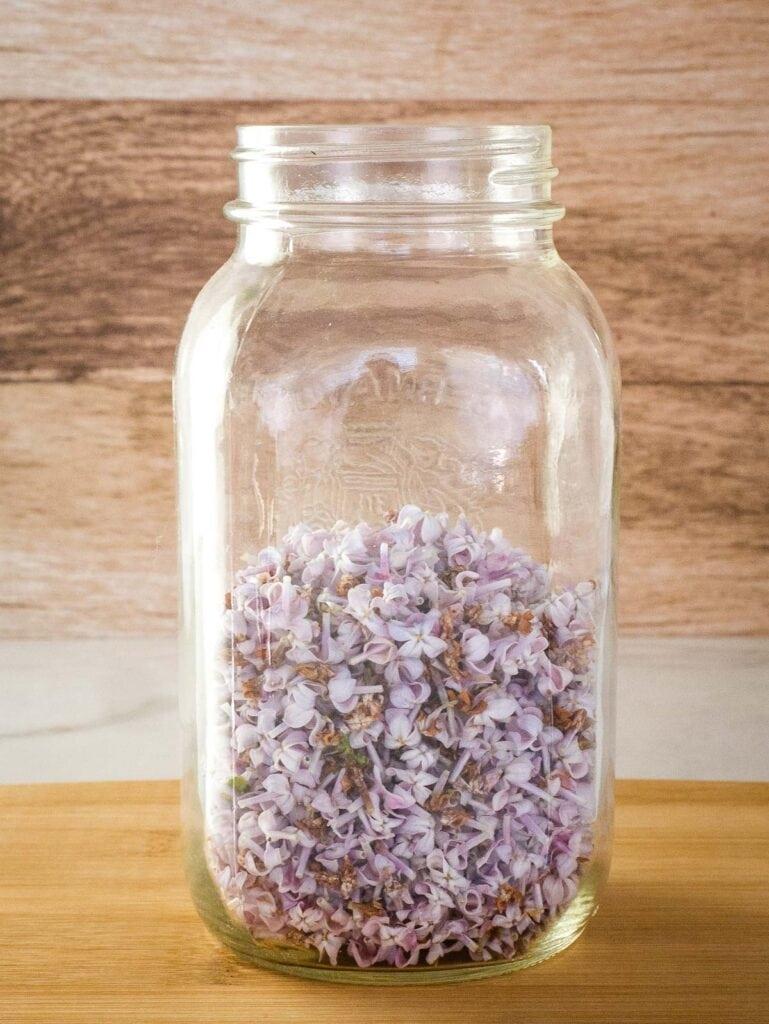 Purple lilac flowers in a jar.